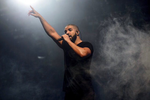 "FILE - In this June 27, 2015 file photo, Canadian singer Drake performs on the main stage at Wireless festival in Finsbury Park, London.  Drake has landed his 208th song on the Billboard Hot 100 chart, setting a new record for most songs on the music chart. The rapper's latest track, ""Oprah's Bank Account"