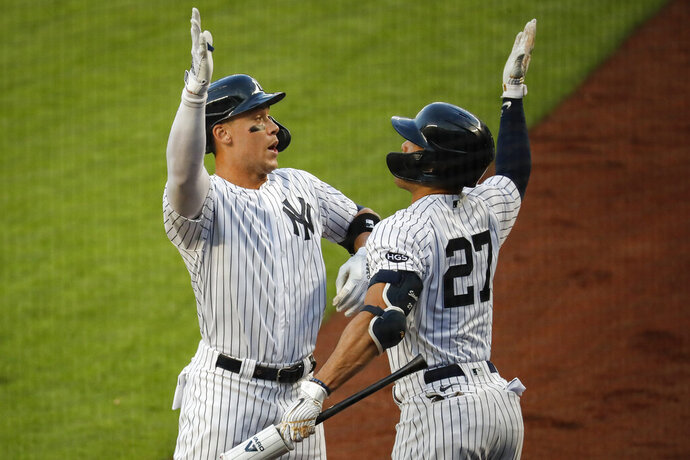 New York Yankees' Aaron Judge, left, celebrates with Giancarlo Stanton after hitting a solo home run off Boston Red Sox starting pitcher Zack Godley during the first inning of a baseball game Saturday, Aug. 1, 2020, in New York. (AP Photo/John Minchillo)