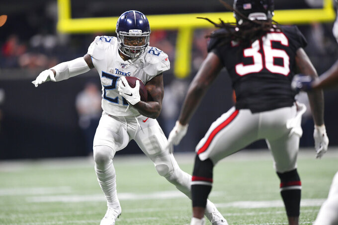 Tennessee Titans running back Derrick Henry (22) runs against Atlanta Falcons defensive back Kemal Ishmael (36) during the first half of an NFL football game, Sunday, Sept. 29, 2019, in Atlanta. (AP Photo/John Amis)