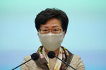 Hong Kong Chief Executive Carrie Lam listens to reporters questions during a press conference in Hong Kong, Tuesday, June 2, 2020. Lam hit out at the