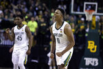 Baylor guard Mark Vital reacts to his blocked shot of Butler late in the second half of an NCAA college basketball game, Tuesday, Dec. 10, 2019, in Waco, Texas. Looking on is Baylor guard Davion Mitchell, left. (AP Photo/Rod Aydelotte)