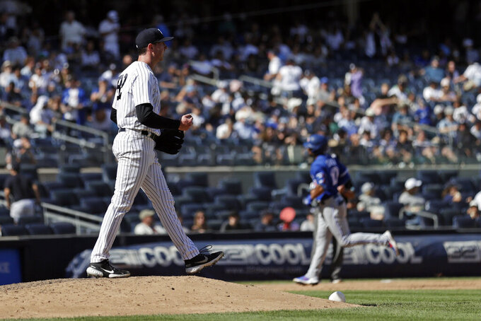 New York Yankees pitcher Brooks Kriske, left, walks over the pitcher's mound after giving up a home run to Toronto Blue Jays' Marcus Semien during the ninth inning of a baseball game on Monday, Sept. 6, 2021, in New York. (AP Photo/Adam Hunger)