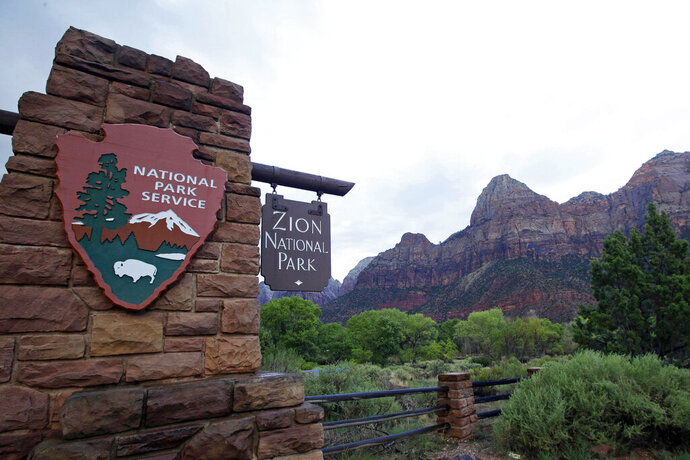 FILE - This Sept. 15, 2015, file photo, shows Zion National Park near Springdale, Utah. Face masks will soon be mandatory in parts of Utah that are home to several of the state's famous national parks. Republican Gov. Gary Herbert has approved requests for face covering mandates in Grand County and the city of Springdale that will go into effect Friday, July 3, 2020. Grand County is home to the popular tourist destination of Moab, which is located right outside Arches and Canyonlands National Parks. Springdale is the gateway town to Zion National Park. The new mask measures come as the state tries to contain a monthlong surge in confirmed COVID-19 cases. (AP Photo/Rick Bowmer, File)