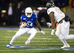 Tulsa running back Corey Taylor II (24) looks for a way around Central Florida defensive lineman Chris DeLoach during an NCAA college football game, Friday, Nov. 8, 2019 in Tulsa, Okla. (Brett Rojo/Tulsa World via AP)