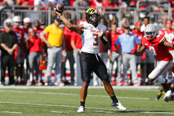 Maryland quarterback Taulia Tagovailoa throws a pass against Ohio State during the first half of an NCAA college football game Saturday, Oct. 9, 2021, in Columbus, Ohio. Ohio State beat Maryland 66-17. (AP Photo/Jay LaPrete)