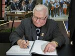 Lech Walesa, the former Polish democracy activisit and ex-president, signs a condolence book for Gdansk Mayor Pawel Adamowicz, who died earlier this week after being stabbed by an ex-convict with a grudge against his former party, in Gdansk, Poland, on Wednesday Jan. 16, 2019. In the condolence book at the European Solidarity Center, Walesa, 75, wrote: