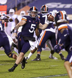 Virginia quarterback Brennan Armstrong (5) throws a pass to tight end Billy Kemp IV (4) during the team's NCAA college football game against North Carolina on Saturday, Oct. 31, 2020, in Charlottesville, Va. (Andrew Shurtleff/The Daily Progress via AP)