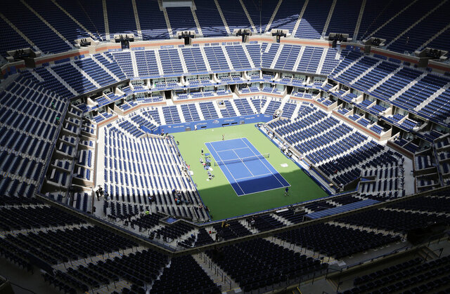 "FILE - In this Aug. 27, 2017, file photo, players practice for the U.S. Open tennis tournament at Arthur Ashe Stadium in New York. As coronavirus cases spike in other parts of the country a month before the U.S. Open is supposed to start in New York, the U.S. Tennis Association said Friday, July 31, 2020, it ""continues its plans"" to hold its marquee event and another tournament beforehand. (AP Photo/Peter Morgan, File)"
