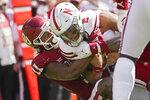 Oklahoma linebacker Nik Bonitto (11) sacks Nebraska quarterback Adrian Martinez (2), in the second half of an NCAA college football game, Saturday, Sept. 18, 2021, in Norman, Okla. (AP Photo/Sue Ogrocki)