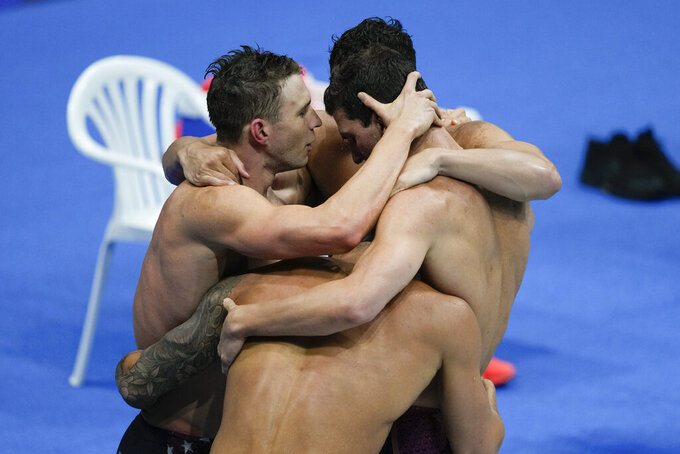 Members of the U.S. men's 4x100-meter medley relay team, Caeleb Dressel, Zach Apple, Ryan Murphy and Michael Andrew, celebrate after winning the gold medal at the 2020 Summer Olympics, Sunday, Aug. 1, 2021, in Tokyo, Japan. (AP Photo/Jae C. Hong)