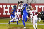San Francisco 49ers cornerback Jason Verrett (22) intercepts a pass in the end zone between Los Angeles Rams wide receiver Robert Woods, left, and Josh Reynolds during the second half of an NFL football game in Santa Clara, Calif., Sunday, Oct. 18, 2020. (AP Photo/Tony Avelar)