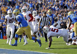 UCLA running back Joshua Kelley, left, scores a rushing touchdown against Stanford during the first half of an NCAA college football game Saturday, Nov. 24, 2018, in Pasadena, Calif. (AP Photo/Marcio Jose Sanchez)