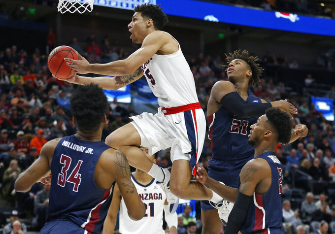 Gonzaga guard Alex Martin (5) goes to the basket as Fairleigh Dickinson's Mike Holloway Jr. (34), Elyjah Williams (21) and Kaleb Bishop (12) defend during the second half of a first-round game in the NCAA men's college basketball tournament Thursday, March 21, 2019, in Salt Lake City. (AP Photo/Rick Bowmer)