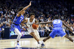 Xavier guard Paul Scruggs (1) drives to the basket as Creighton guard Ty-Shon Alexander (5) and forward Damien Jefferson (23) defend in the first half of an NCAA college basketball game Saturday, Jan. 11, 2020, in Cincinnati. (Kareem Elgazzar/The Cincinnati Enquirer via AP)