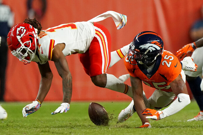 Denver Broncos cornerback Chris Harris (25) breaks up a pass intended for Kansas City Chiefs wide receiver Demarcus Robinson during the second half of an NFL football game, Thursday, Oct. 17, 2019, in Denver. (AP Photo/Jack Dempsey)