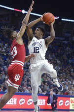 Penn State's Izaiah Brockington (12) shoots over Indiana's Damezi Anderson (23) during the first half of an NCAA college basketball game Wednesday, Jan. 29, 2020, in State College, Pa. (AP Photo/Gary M. Baranec)