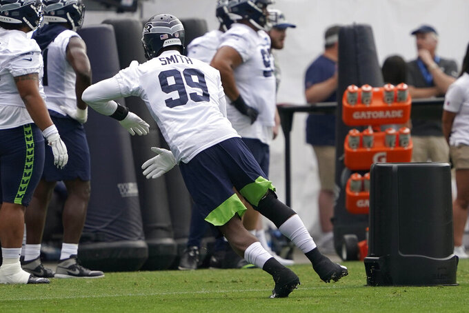 Seattle Seahawks defensive end Aldon Smith runs a drill during NFL football practice Saturday, July 31, 2021, in Renton, Wash. (AP Photo/Ted S. Warren)