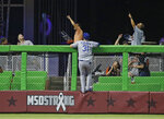Los Angeles Dodgers left fielder Joc Pederson hangs on the fence as he watches a home run by Miami Marlins' J.T. Realmuto go into the stands during the sixth inning of a baseball game, Wednesday, May 16, 2018, in Miami. The Marlins defeated the Dodgers 6-5. (AP Photo/Wilfredo Lee)