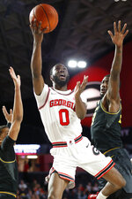 Georgia guard William Jackson II (0) shoots while being defended by Missouri guard Javon Pickett (4) and forward Jeremiah Tilmon (23) during the first half of an NCAA college basketball game Wednesday, March 6, 2019, in Athens, Ga. (Joshua L. Jones/Athens Banner-Herald via AP)