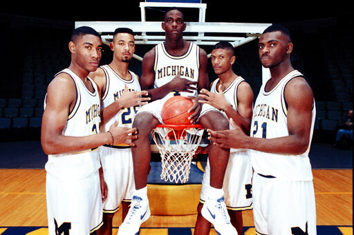 FILE - In this November 1991, file photo, Michigan's Fab Five from left, Jimmy King, Juwan Howard, Chris Webber, Jalen Rose and Ray Jackson pose in Ann Arbor, Mich. Michigan coach Juwan Howard was honored as The Associated Press men's basketball coach of the year Thursday, April 1, 2021. (AP Photo/File)