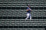 Boston Red Sox's Michael Chavis walks in the bleachers during baseball practice at Fenway Park, Sunday, July 5, 2020, in Boston. (AP Photo/Michael Dwyer)