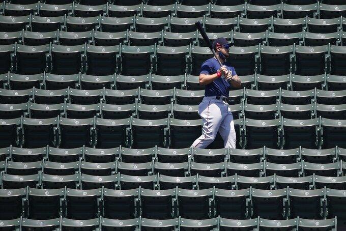 Boston Red Sox's Michael Chavis walks in the bleachers during baseball practice at Fenway Park, Sunday, July 5, 2020, in Boston. (AP Photo/Michael Dwyer)