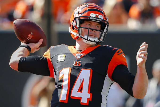 Cincinnati Bengals quarterback Andy Dalton passes in the first half of an NFL football game against the Jacksonville Jaguars, Sunday, Oct. 20, 2019, in Cincinnati. (AP Photo/Gary Landers)