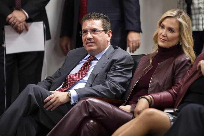 FILE - Washington Redskins owner Dan Snyder, left, and his wife Tanya Snyder, listen to head coach Ron Rivera during a news conference at the team's NFL football training facility in Ashburn, Va., in this Thursday, Jan. 2, 2020, file photo. Dan Snyder's wife Tanya was named co-CEO of the Washington Football Team on Tuesday, June 29, 2021, giving her bigger influence in the club that is currently in the midst of an independent investigation into workplace conduct the NFL is overseeing. (AP Photo/Alex Brandon, File)