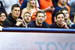 New England Patriots' Tom Brady, left, and Julian Edelman, center, along with comedian Jimmy Fallon watch from the sidelines during the first half of an NCAA college basketball game between Syracuse and North Carolina in Syracuse, N.Y., Saturday, Feb. 29, 2020. (AP Photo/Adrian Kraus)