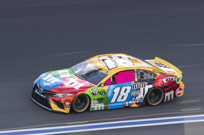 Kyle Busch (18) drives during a NASCAR Cup Series auto racing race at Charlotte Motor Speedway, Sunday, Oct. 10, 2021, in Concord, N.C. (AP Photo/Matt Kelley)