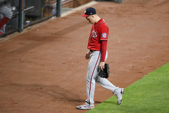 Washington Nationals starting pitcher Patrick Corbin walks to the dugout after he was pulled during the sixth inning of the team's baseball game against the Baltimore Orioles, Friday, July 23, 2021, in Baltimore. (AP Photo/Nick Wass)
