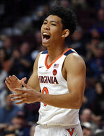 Virginia's Kihei Clark reacts during the first half of an NCAA college basketball game against Arizona State, Sunday, Nov. 24, 2019, in Uncasville, Conn. (AP Photo/Jessica Hill)