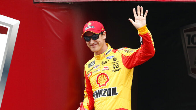 Monster Energy NASCAR Cup Series driver Joey Logano (22) waves at driver introductions during a NASCAR Cup Series auto race at Talladega Superspeedway, Sunday, Oct. 14, 2019, in Talladega, Ala. (AP Photo/Butch Dill)