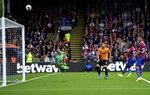 Wolverhampton Wanderers' Matt Doherty (third right) shoots towards the goal but misses during their English Premier League soccer match against Crystal Palace at Selhurst Park, London, Sunday, Sept. 22, 2019. (Daniel Hambury/PA via AP)