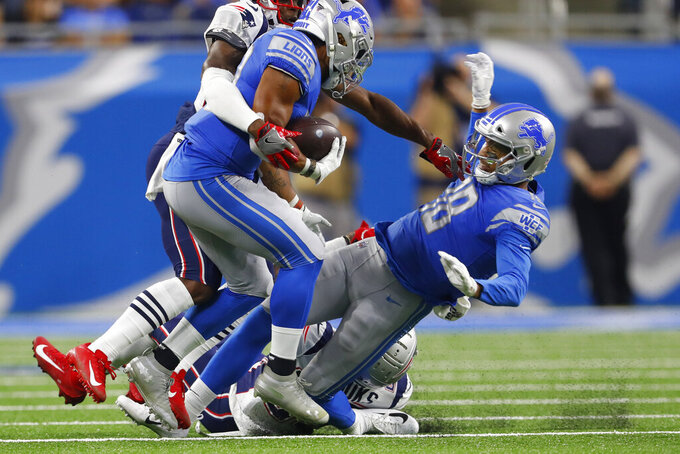 FILE - In this Thursday, Aug. 8, 2019 file photo, Detroit Lions wide receiver Jermaine Kearse, right, hurts his left leg while trying block for running back Ty Johnson during an NFL preseason football game against the New England Patriots in Detroit. The Detroit Lions have placed wide receiver Jermaine Kearse on injured reserve and signed quarterback Josh Johnson. Kearse hurt his left leg during Detroit's first possession of Thursday's preseason opener against New England, a 31-3 loss. (AP Photo/Paul Sancya, File)