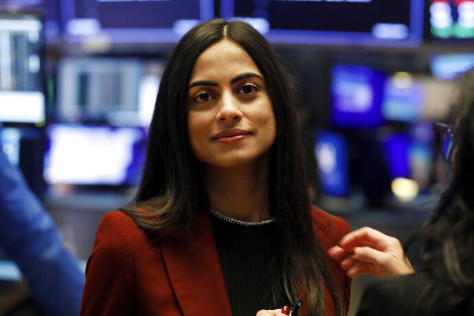 FILE - In this Feb. 5, 2020 file photo, Dhivya Suryadevara, executive vice president and Chief Financial Officer of General Motors, visits the trading floor of the New York Stock Exchange.  Suryadevara is leaving the automaker for the same position at Silicon Valley's hottest startup, the software and mobile payment company Stripe.  (AP Photo/Richard Drew, File)
