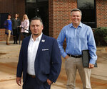 """This Nov. 1, 2018 photo shows Epic Charter Schools Superintendent David Chaney, left, and founder Ben Harris, right in Oklahoma City, Oka.  An investigation into the founders of an online charter school in Oklahoma is just the latest in a series of similar probes taking place across the country. Oklahoma investigators last week wrote in a court affidavit that Epic Charter Schools co-founders Ben Harris and David Chaney recruited """"ghost students"""" who received little or no instruction. (Photo by Jim Beckel, The Oklahoman via AP)"""