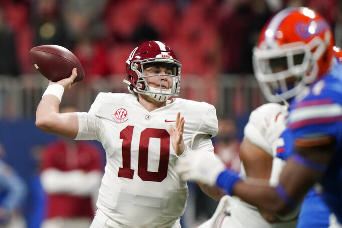 FILE - In this Saturday, Dec. 19, 2020, file photo, Alabama quarterback Mac Jones (10) throws a pass against Florida during the first half of the Southeastern Conference championship NCAA college football game in Atlanta. Jones has been named a finalist for the Heisman Trophy. The Heisman will be awarded Jan. 5 during a virtual ceremony as the pandemic forced the cancellation of the usual trip to New York that for the presentation that usually comes with being a finalist. (AP Photo/Brynn Anderson, File)