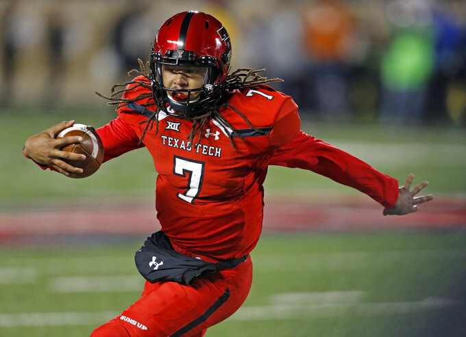 Texas Tech's Jett Duffey runs with the ball during the first half of an NCAA college football game against Texas, Saturday, Nov. 10, 2018, in Lubbock, Texas. (AP Photo/Brad Tollefson)