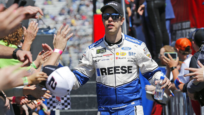 NASCAR Cup Series driver Brad Keselowski (2) greets fans during driver introductions prior to the NASCAR Cup Series auto race at the Martinsville Speedway in Martinsville, Va., Sunday, March 24, 2019. (AP Photo/Steve Helber)
