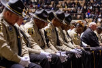 Deputies from the Lowndes County Sheriff's department bow their heads in prayer during the eulogy at the memorial service for slain Lowndes County Sheriff