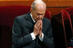 FILE - In this Oct. 6, 2018, file photo, The Church of Jesus Christ of Latter-day Saints President Russell M. Nelson prays during the church's twice-annual conference, in Salt Lake City. The recent slaying in Mexico of nine people who belonged to a Mormon offshoot community where some people practice polygamy shines a new spotlight on the ongoing struggle for the mainstream church to fight the association with plural marriage groups because of its past. The Church of Jesus Christ of Latter-day Saints issued a statement expressing sympathy for the victims, while also pointing out the people didn't belong to the church. (AP Photo/Rick Bowmer, File)