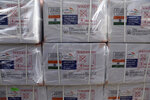 FILE - In this Feb. 7, 2021, file photo, boxes of the first shipment of 500,000 doses of the AstraZeneca coronavirus vaccine made by Serum Institute of India, donated by the Indian government, await distribution at the customs area of the Hamid Karzai International Airport, in Kabul, Afghanistan. A vaccine shortage stems mostly from India's decision to stop exporting the vaccines from its Serum Institute factory, which produces the overwhelming majority of the AstraZeneca doses that the COVAX global initiative was counting on to supply to about a third of the world's population. (AP Photo/Rahmat Gul, File)