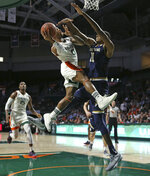 Miami guard Chris Lykes (0) goes to the basket against Notre Dame forward Juwan Durham (11) during the first half of an NCAA college basketball game, Wednesday, Feb. 6, 2019 in Coral Gables, Fla. (David Santiago/Miami Herald via AP)
