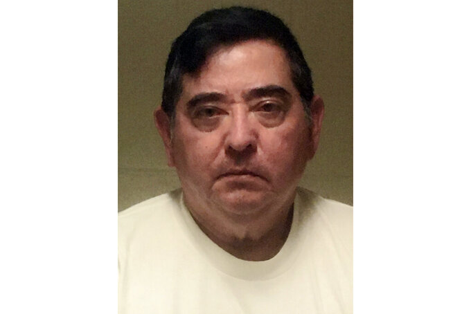 In this undated photo released by Kauai Police Department is Victor Aguilar. U.S. prosecutors want a former Junior ROTC instructor at a Hawaii high school to remain locked up pending trial because he allegedly sexually abused a student and filmed the abuse. Victor Aguilar appeared for a court appearance by phone from the Honolulu Federal Detention Center on Monday, March 29, 2021. (Kauai Police Department via AP)