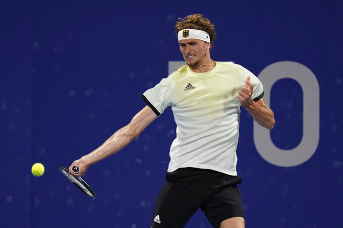 Alexander Zverev, of Germany, returns to Jeremy Chardy, of France, during the quarterfinal round of the men's tennis competition at the 2020 Summer Olympics, Thursday, July 29, 2021, in Tokyo, Japan. (AP Photo/Patrick Semansky)