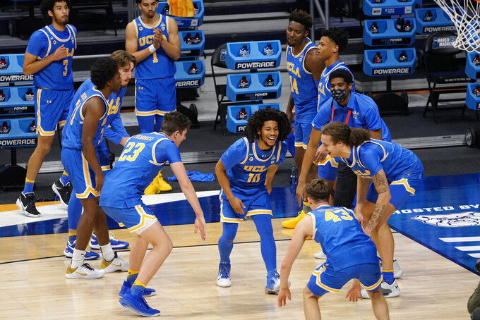 UCLA players prepare for a first-round game against BYU in the NCAA men's college basketball tournament at Hinkle Fieldhouse in Indianapolis, Saturday, March 20, 2021. (AP Photo/AJ Mast)