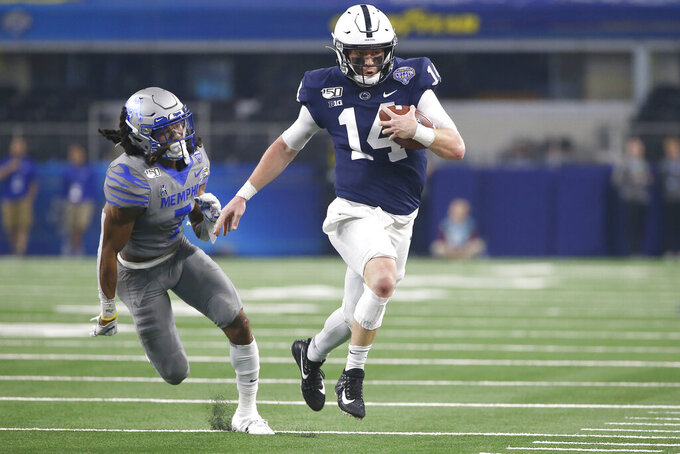 Penn State quarterback Sean Clifford (14) carries the ball as Memphis defensive back Chris Claybrooks (7) closes in during the first half of the NCAA Cotton Bowl college football game, Saturday, Dec. 28, 2019, in Arlington, Texas. (AP Photo/Ron Jenkins)