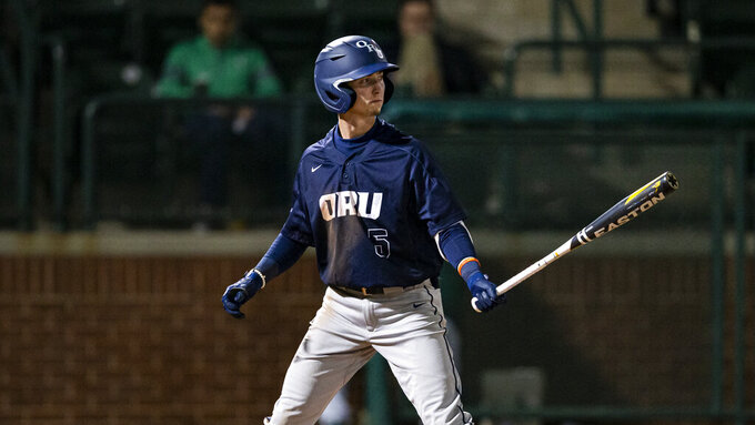 FILE - Oral Roberts junior Ryan Cash bats during an NCAA baseball game against Baylor in Waco, Texas, in this Friday, Feb. 21, 2020, file photo. Ryan Cash had five hits and five RBIs as Oral Roberts won two of three games against nationally ranked LSU in Baton Rouge, Louisiana, this past weekend. Oral Roberts won a series against an opponent from the Southeastern Conference for the first time since 2017. (AP Photo/Brandon Wade, File)