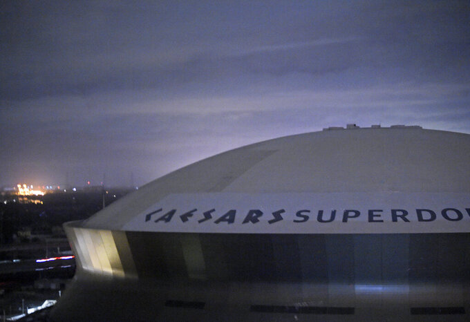 FILE - This early Monday, Aug. 30, 2021, file photo, shows the Caesars Superdome, home of the New Orleans Saints NFL football team in New Orleans, La., after Hurricane Ida.  The NFL announced Wednesday, Sept. 1, 2021, that the Saints will host the Green bay Packers in Jacksonville, Fla., in a Sept. 12 season opener after being displaced by Hurricane Ida. (Max Becherer/The Times-Picayune/The New Orleans Advocate via AP)